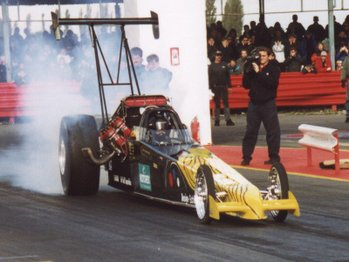 A Top Fuel dragster, the ultimate in drag racing. Get too close without ear protection and it will cause deafness.