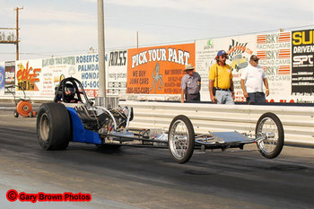 Front engine dragsters are what they raced in the 1960's. These cars are still in competition today and they attract big crowds. This car would've been a Jr. Fueler in the 1960's.
