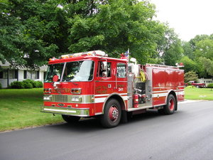 Fire Engine in South Bend, Indiana.  Note the pump equipment in the middle of the vehicle's side.