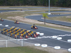 Kart racers race each other on a outdoor track