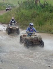 "A group of ""quad bike� all terrain vehicles"