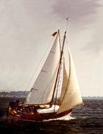 Traditional wooden cutter under sail.
